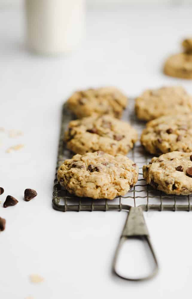 baked oatmeal chocolate chip cookies cooking on a cooling rack