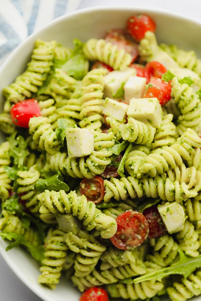 close up on pasta salad in a white bowl