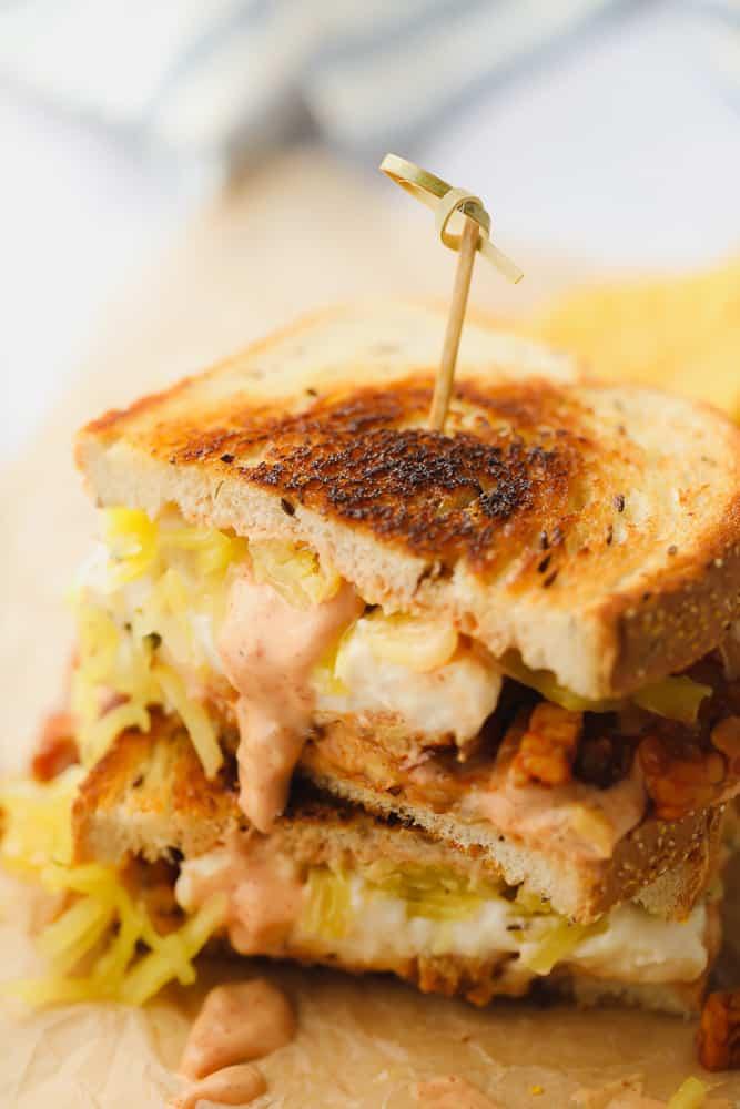 2 halfs of a vegan reuben sandwich on top of each other