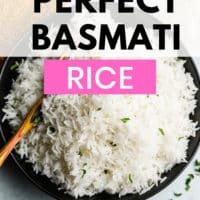pinterest image of a wooden spoon taking a scoop of white rice out of a black bowl