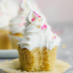 square photo of cupcake with frosting and sprinkles