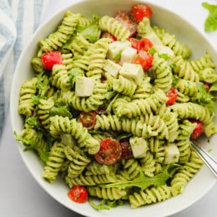 square image of a pesto pasta salad with tomatoes