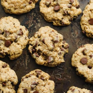 rows of baked oatmeal chocolate chip cookies on a baking sheet