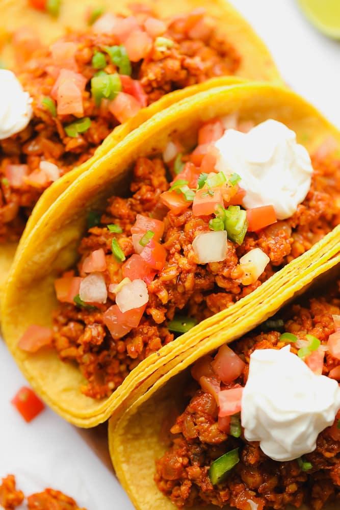 close up on 3 corn tortilla tempeh tacos