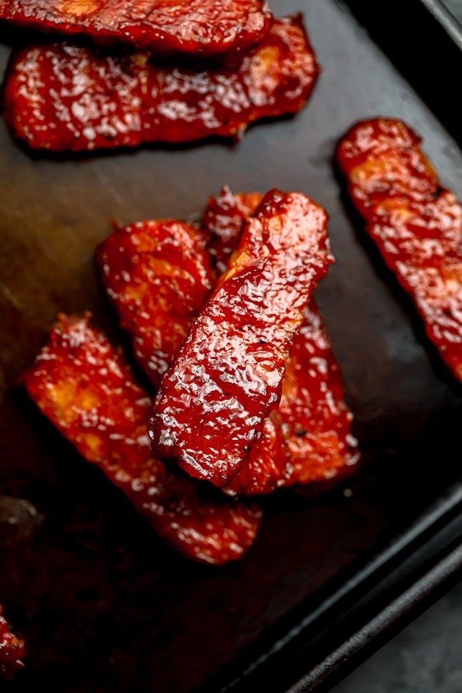 few pieces of cooked bbq tempeh ribs
