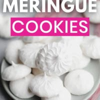 pinterest image of a pile of white vegan meringues cookies on a small grey plate