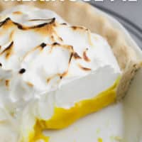 pinterest image of a close up on a lemon meringue pie with a slice removed
