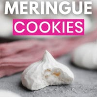 pinterest image of a white meringue cookie with a bite out of it