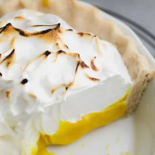 close up on a lemon meringue pie with a slice removed