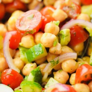 close up on a chickpea salad with tomatoes and cucumbers
