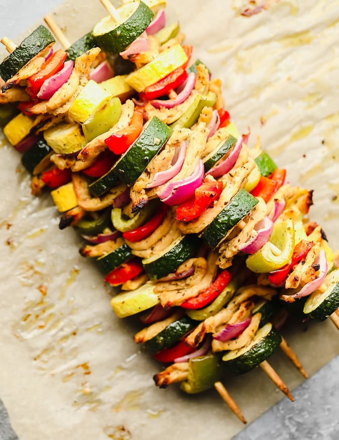 cooked vegetable kebabs piled on top of each other