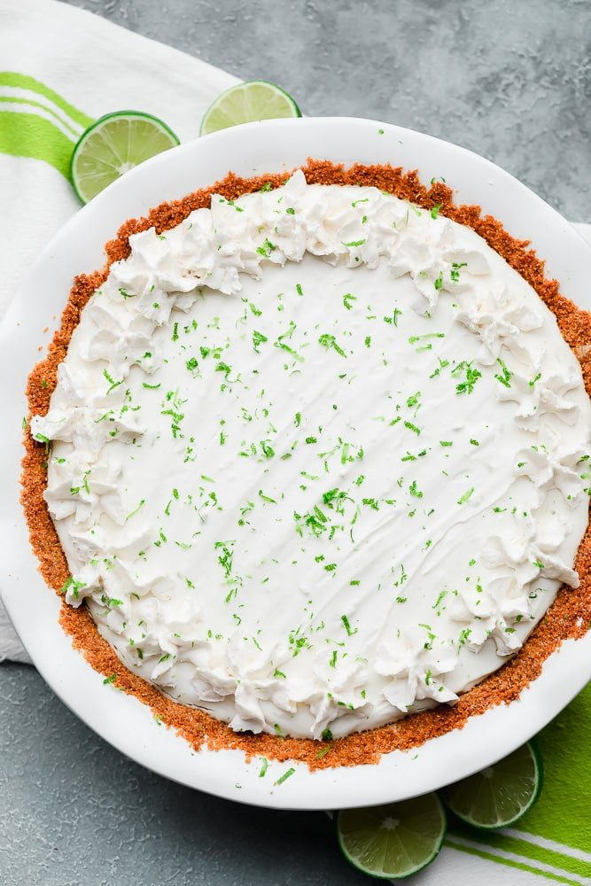 white key lime pie in a white pie plate