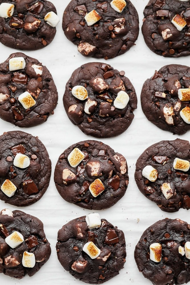 rows of baked chocolate marshmallow cookies on parchment paper