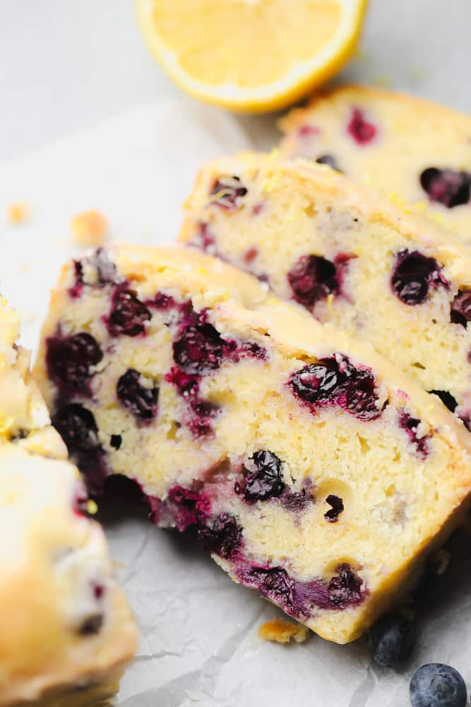 close up on 3 slices of blueberry and lemon bread
