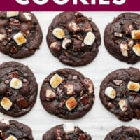 pinterest image of rows of baked chocolate marshmallow cookies on parchment paper