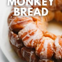 pinterest image of a baked and glazed circle of golden brown monkey bread