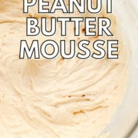 pinterest image of a glass bowl filled with a beige, creamy peanut butter mousse