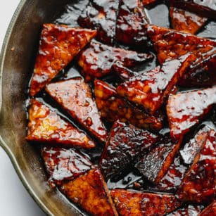 square image of marinated tempeh in pan