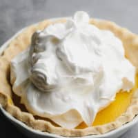 square image with meringue from aquafaba on a pie