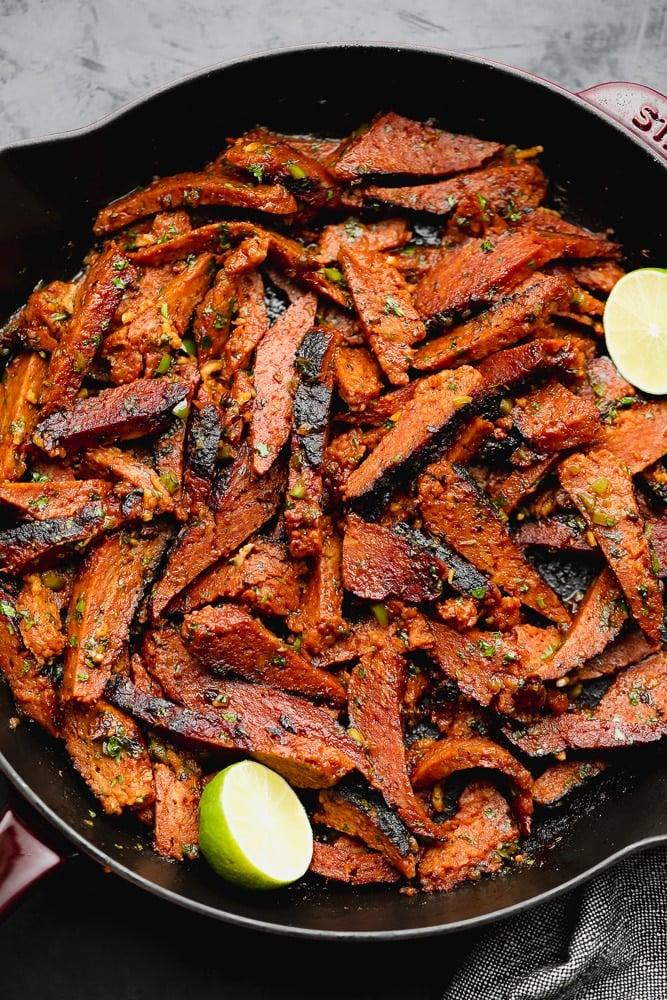 cast iron pan full of mock seitan meat that looks seasoned