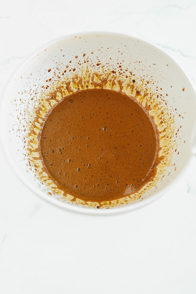 light brown liquid in a large white bowl