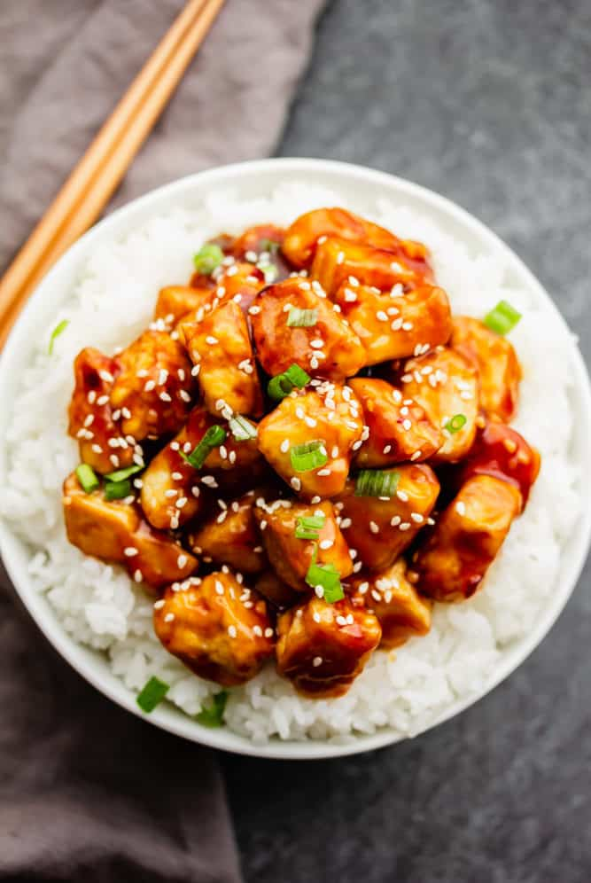 bowl with white rice and lots of general tso tofu in sauce