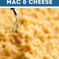 pinterest image of a metal spoon taking a scoop of mac and cheese out of a pot