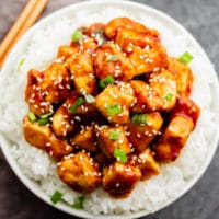 square image of tofu over rice