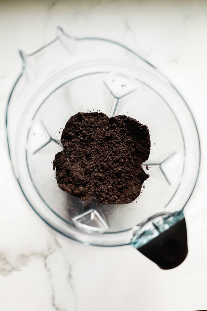 crumbled dark brown cookies in a blender