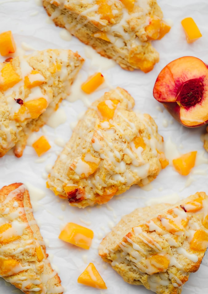 baked peach scones next to sliced and cubed peaches