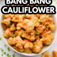 pinterest image of fried breaded cauliflower wings with creamy sauce in a white bowl