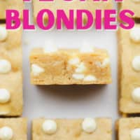 pinterest image of baked blondies with white chocolate chips cut into squares