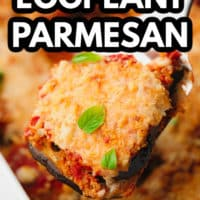 pinterest image of a spatula scooping a slice of eggplant parmesan out of a baking dish.