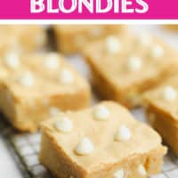 pinterest image of baked blondies cut into squares sitting on a wire rack
