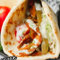 pinterest image of a close up on a vegetable shawarma wrapped in tin foil.