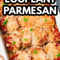 pinterest image of baked eggplant slices with red sauce and melted cheese on top in a white baking dish.