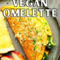 pinterest image of a cooked vegan omelette next to fruit and bread on a grey plate