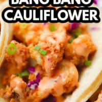 pinterest image of fried cauliflower with orange sauce, purple cabbage, and green herbs in a flour tortilla