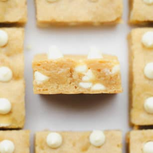 baked blondies with white chocolate chips cut into squares