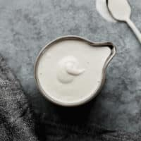 square image of cream in a grey pitcher