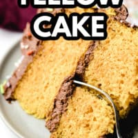pinterest image of a fork taking a bite out of a piece of yellow cake on a white plate.