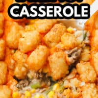 pinterest image of a metal spoon scooping some baked tater tot casserole out of a white casserole dish.