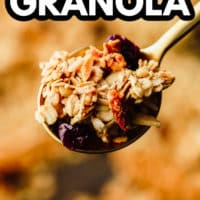 pinterest image of a spoonful of homemade granola.