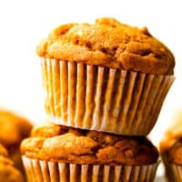 square image of muffin on top of another orange muffin