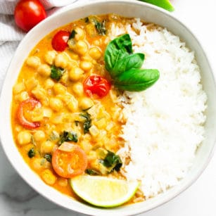 square image of curry in a bowl with rice